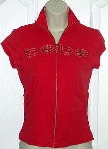 bebe rhinestone logo mock neck short sleeve jacket shirt top small