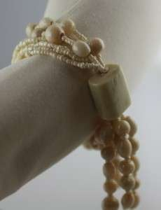 Shimmery multi strand stretch bead seed bracelet cream pearlike glass