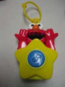 Tyco Press 1996 Sesame Street Elmo Talking/Singing Crib Side Toy Clips